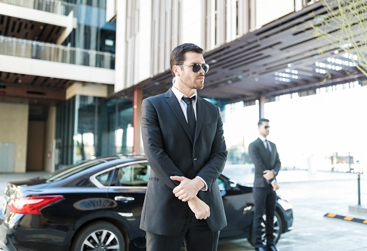 """Hiring a security guard for your business, event, or celebration can keep things safe and secure and lower the odds of theft and other hostile actions. Before you choose a security company in San Diego, it's best to know what types of security services are available, ensuring you find the best option based on your needs. Below are different kinds of security services and reasons they can benefit your event or company. Patrol Guards Some businesses need security guards to monitor their buildings and keep everything operating smoothly. Having a patrol guard on-site can reduce the risk of thieves getting into your building. A professional will know what to look for when patrolling the property and can alert you and the authorities about any suspicious activities. In many cases, burglars will avoid an office building that has security guards patrolling the property. If someone burglarizes your building, the guard can make a citizen's arrest and hold the thieves until police officers arrive to make an official arrest. Personal Guards While traveling to different locations or attending a public event, you may feel safer knowing you have a personal guard who can shadow you. This type of guard will focus solely on your safety and work to protect you in various situations. Depending on how long the event is, you may have two personal guards who rotate in and out, but you'll never be left alone. These security guards typically require extra training, and they could be more expensive than other guards. Uniform & Plainclothes Guards Some guards wear attire that clearly describes their jobs, with wording like """"security"""" on the back or front of their shirts. Others wear accessories based on their training and permit levels, which can include guns and other weapons. If you want your security guards to be incognito, they should dress in plain clothes. An undercover guard can appear to be a regular guest at a party and shock thieves when making a citizen's arrest. Having uniformed o"""